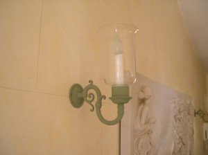 Finished lights in pale green give a softer look to the entryway