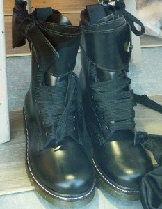 Combat boots with leather wrap-around tops