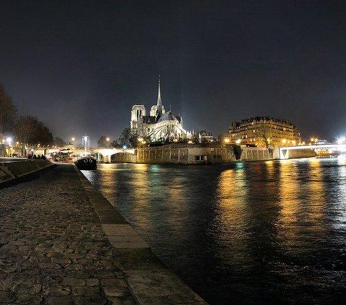 Walking along the Seine after dark