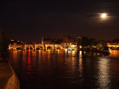Walking along the Seine in Paris at Night