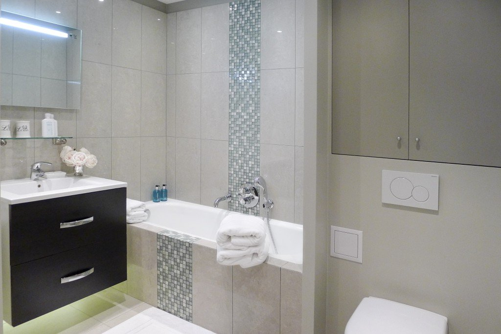 3i en suite bathroom blue mosaic and beige tiles