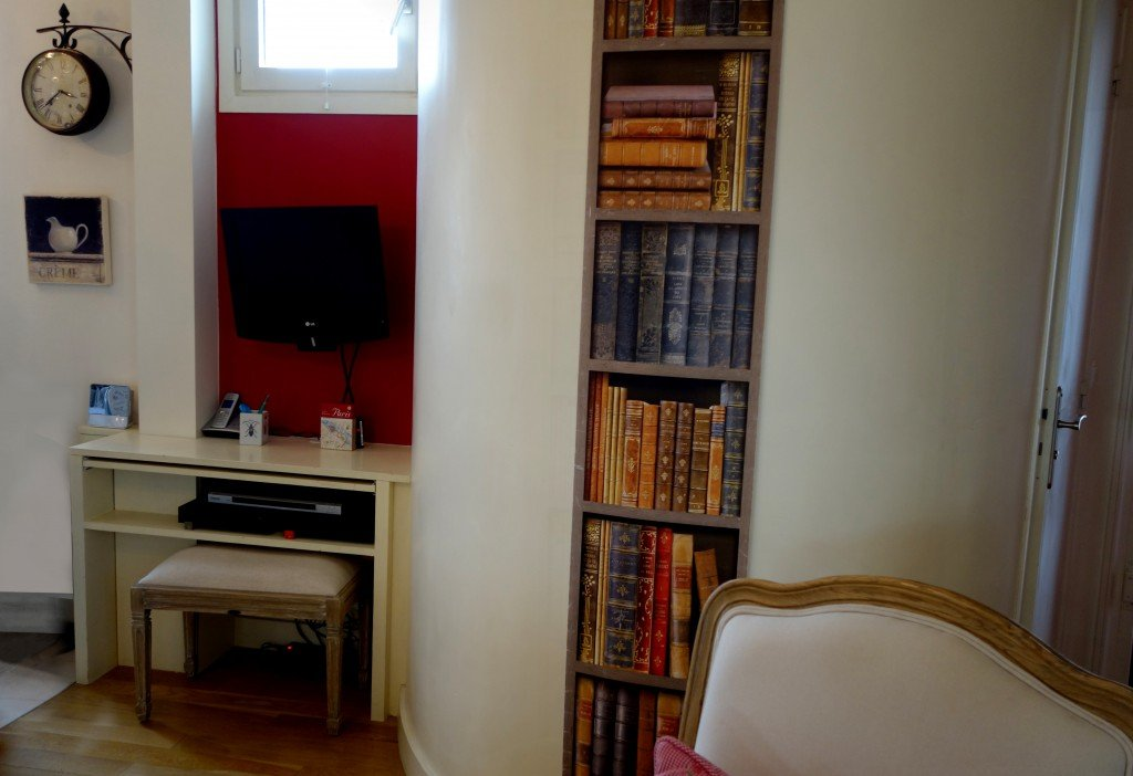 old bookshelf red wall above desk