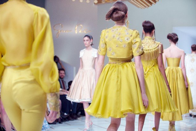 Luxurious yellow gowns at the Guo Pei Show