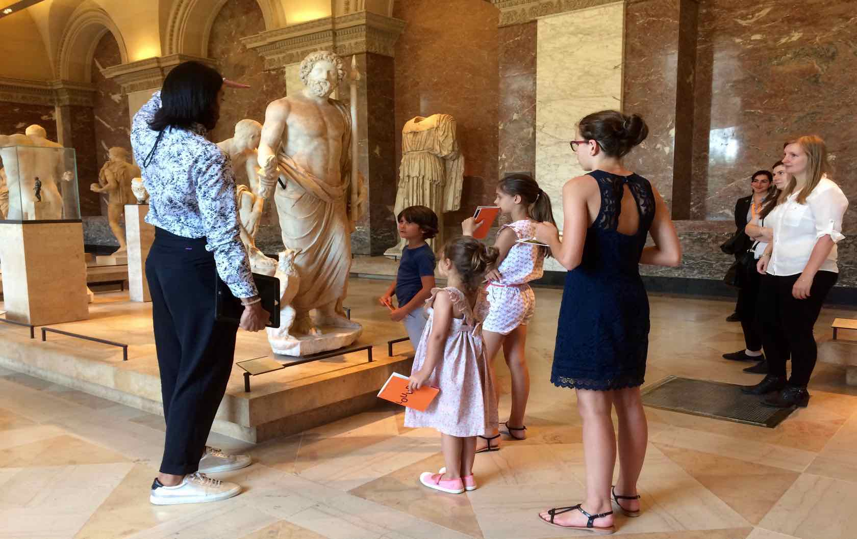 Fun things to do with the Family in Paris during the Summer by Paris Perfect kids at the Louvre