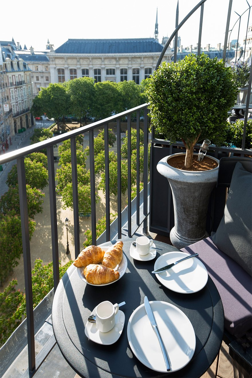 View of Place Dauphine from the Monbazillac apartment- 25 Place Dauphine- 7 of Our Most Instagrammable Apartments in Paris by Paris Perfect