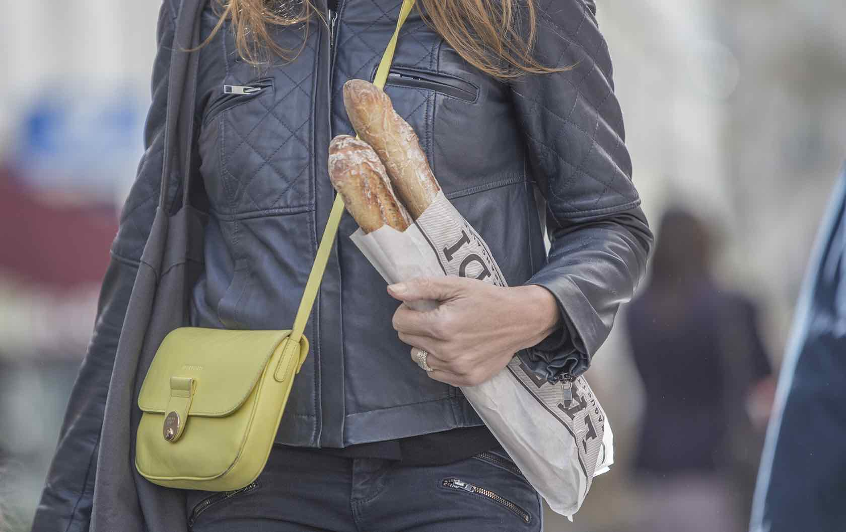 Paris tips woman with baguette