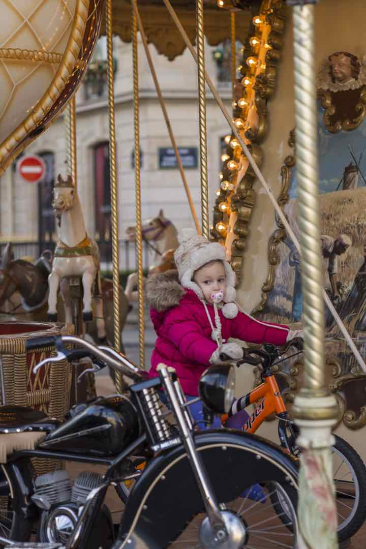 Visit Paris in the Winter Child on caroucel