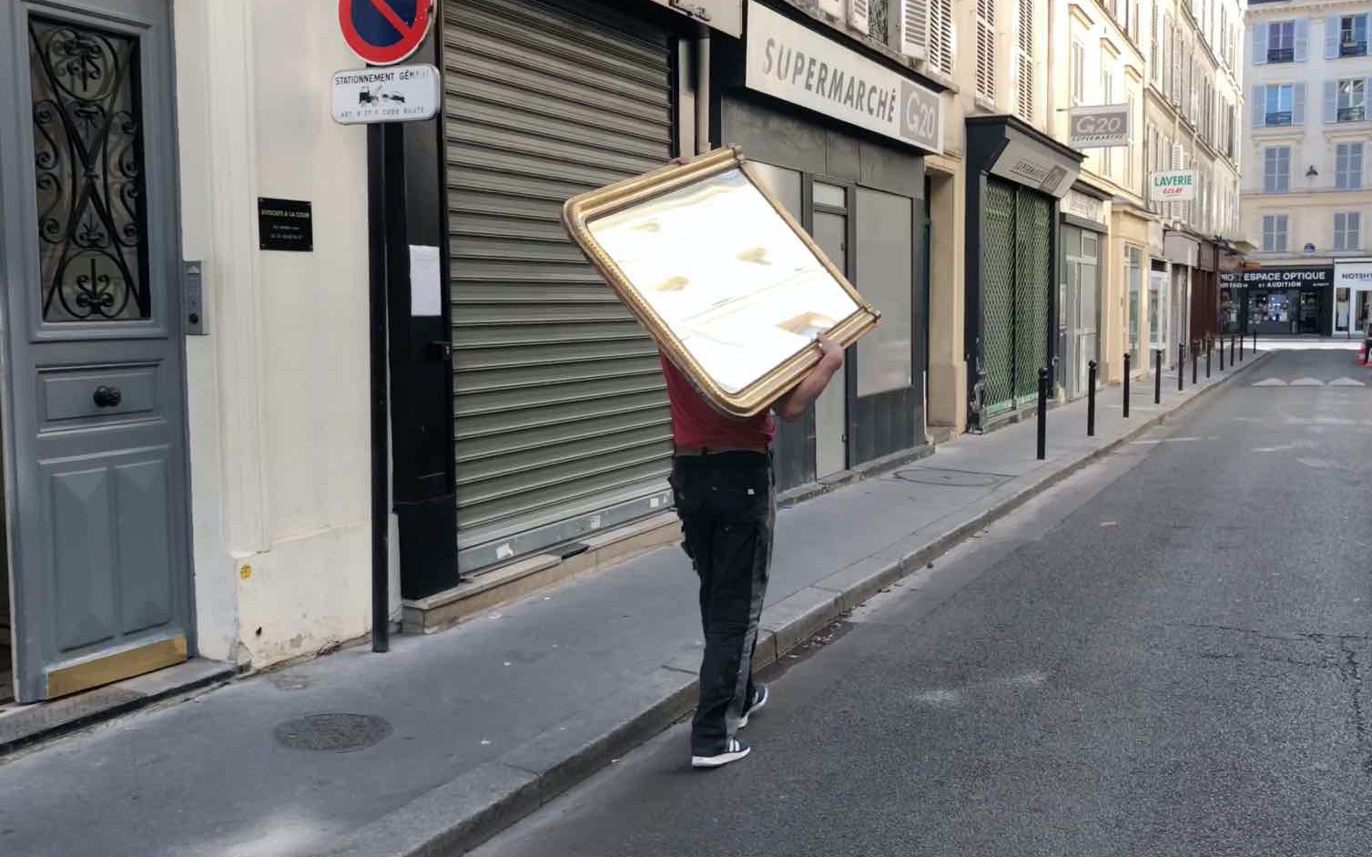 man carrying a mirror