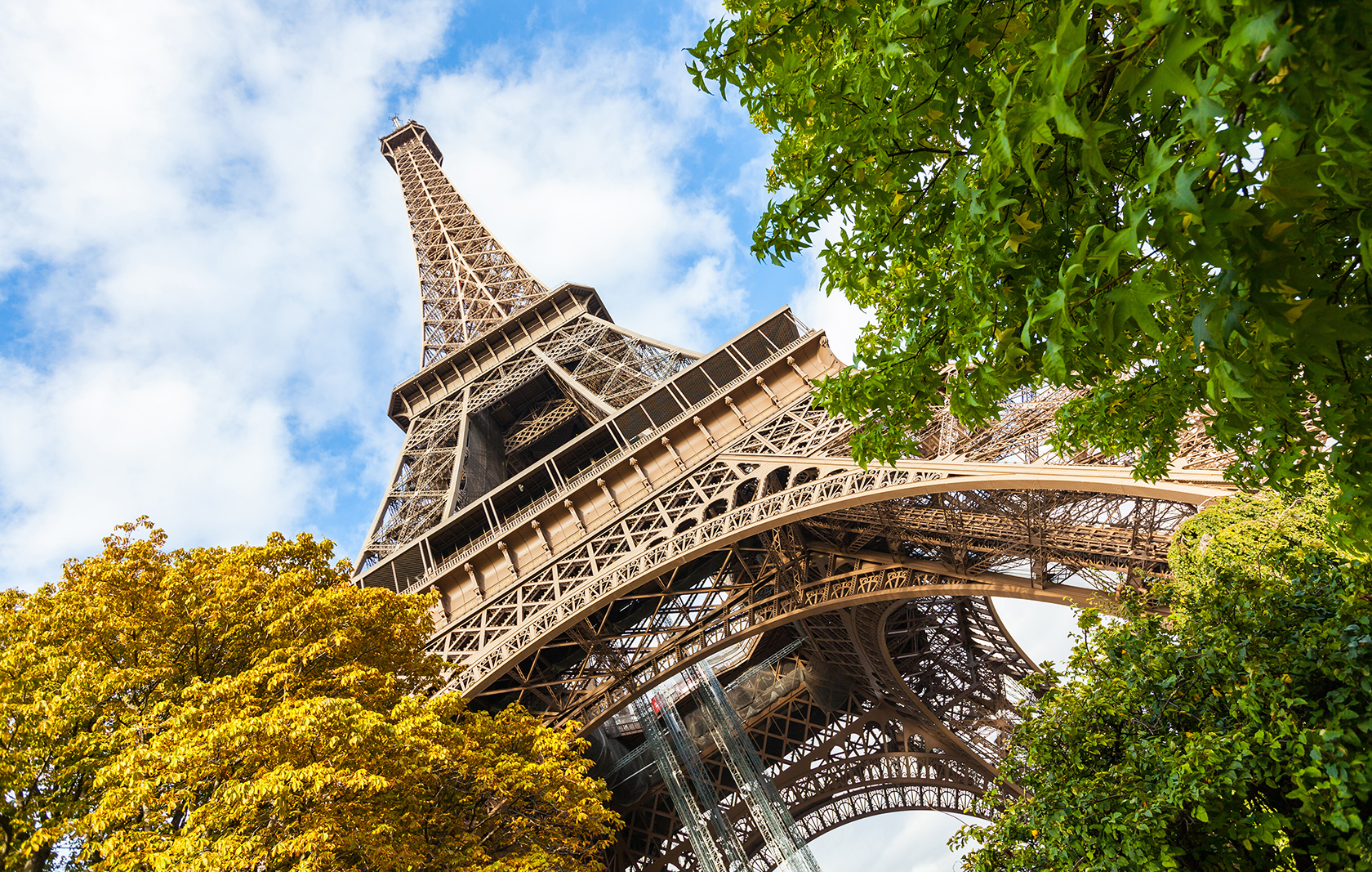 A close view from the base of the Eiffel Tower in Paris