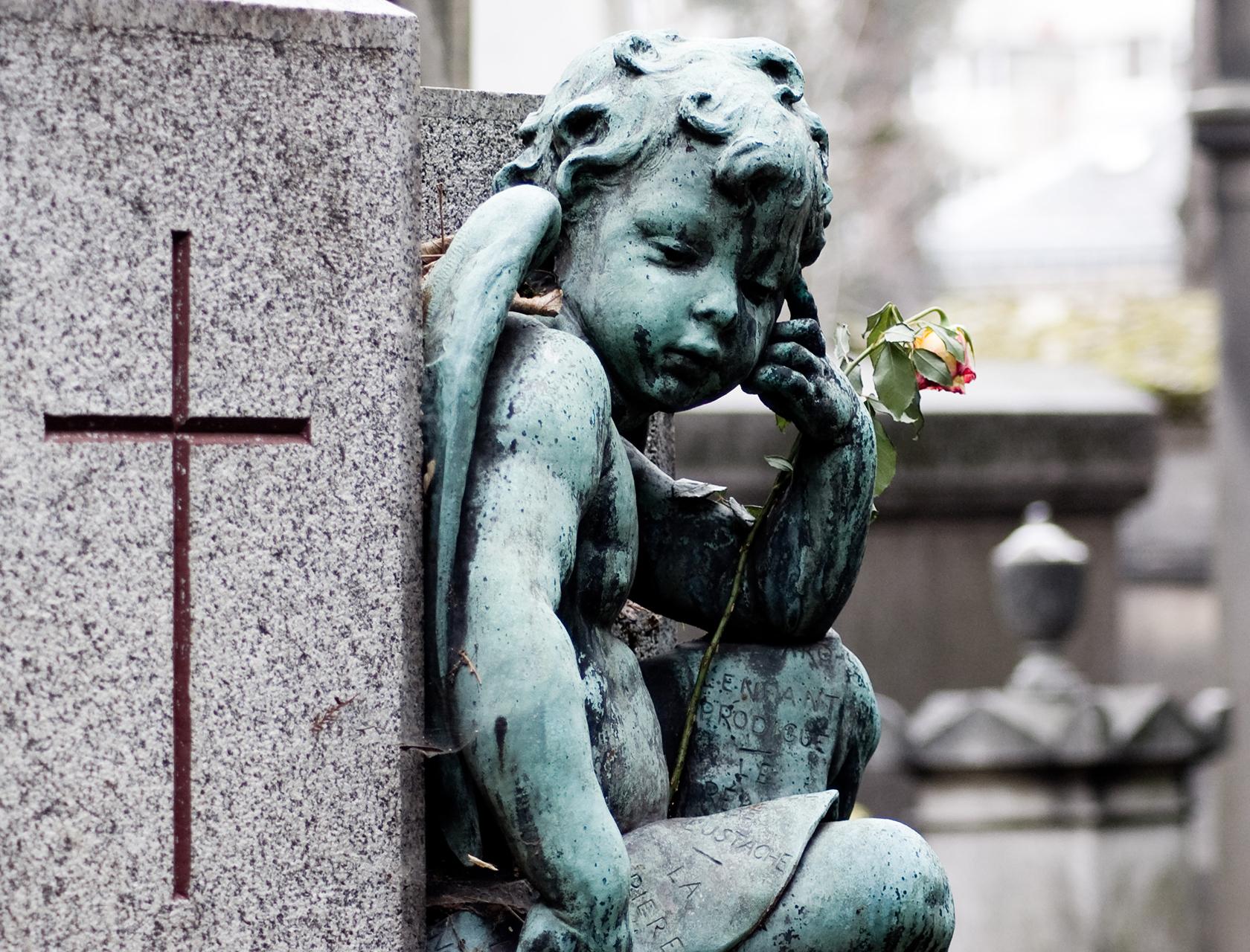 Cherub statue in Père Lachaise Cemetery in Paris
