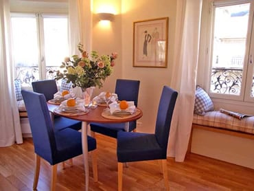 We moved the kitchen to the entryway and converted the space to a living room and dining area with window seats to enjoy the view
