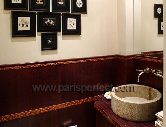 Guest powder room located off entry to Paris apartment