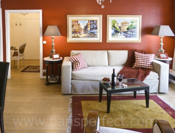 Living Room Decorated In Red And Beige