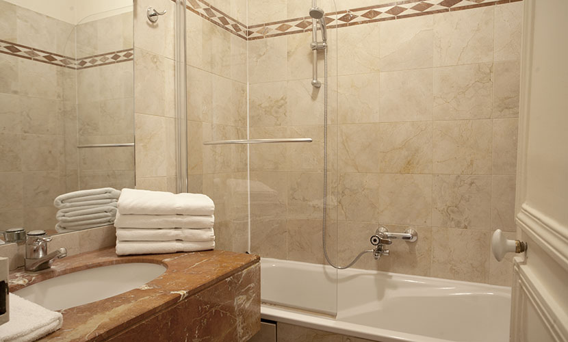 Second bathroom in the Paris rental has a bathtub and shower
