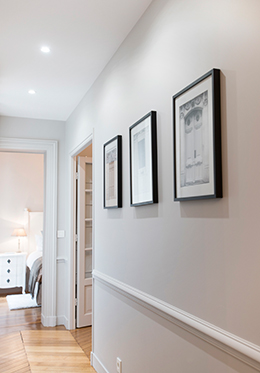 Photographs of Paris adorn the hallway walls in the Monthelie vacation rental offered by Paris Perfect