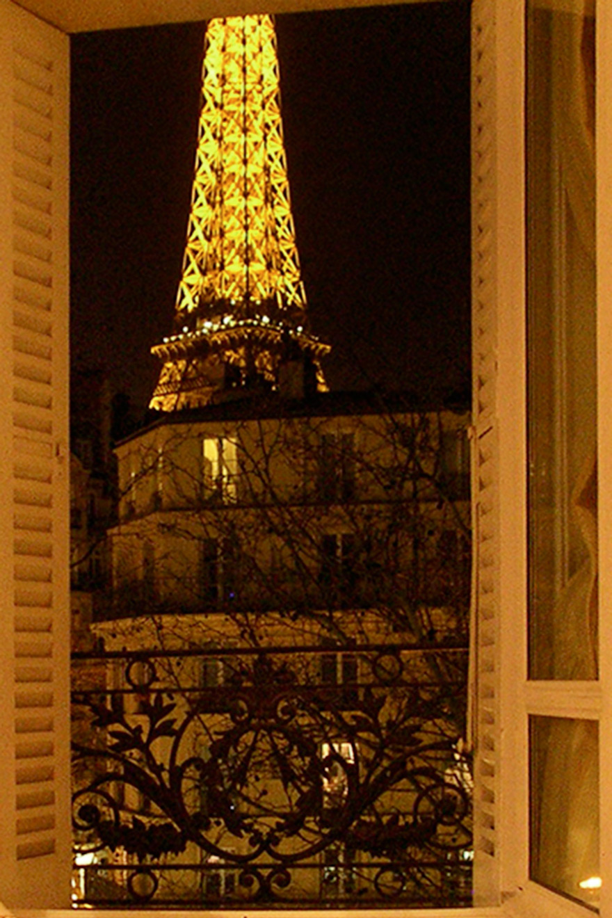 Gorgeous Eiffel Tower view from living room sofa