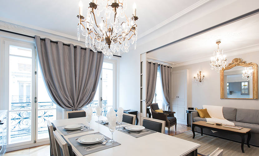 View of the living room from the stunning dining area of the Monthelie vacation rental offered by Paris Perfect