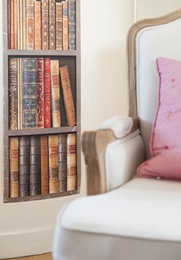Faux bookshelf on corner wall