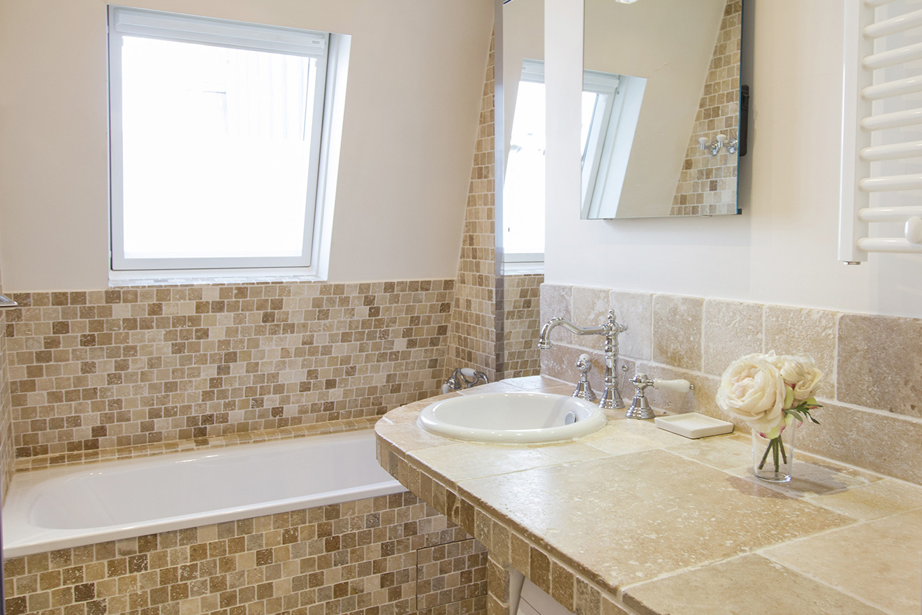 Beautiful bathroom with bathtub in the Chablis vacation rental offered by Paris Perfect