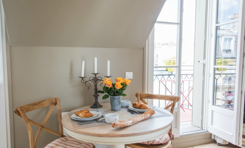 Dining room table seats two in the Saumur vacation rental offered by Paris Perfect
