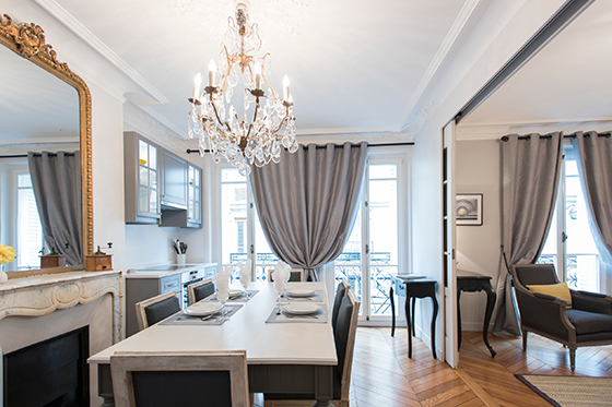 View of the kitchen and dining area of the Monthelie vacation rental offered by Paris Perfect