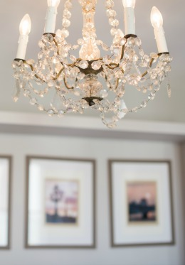 Crystal chandelier hangs above the room in the Saumur vacation rental offered by Paris Perfect