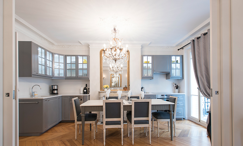Open plan kitchen/dining room in the Monthelie vacation rental offered by Paris Perfect