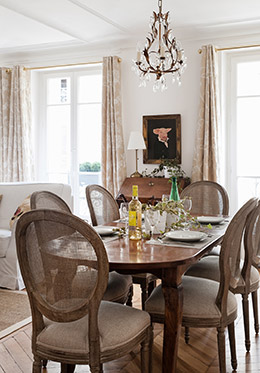 Dining room table seats six people in the Montagny vacation rental offered by Paris Perfect