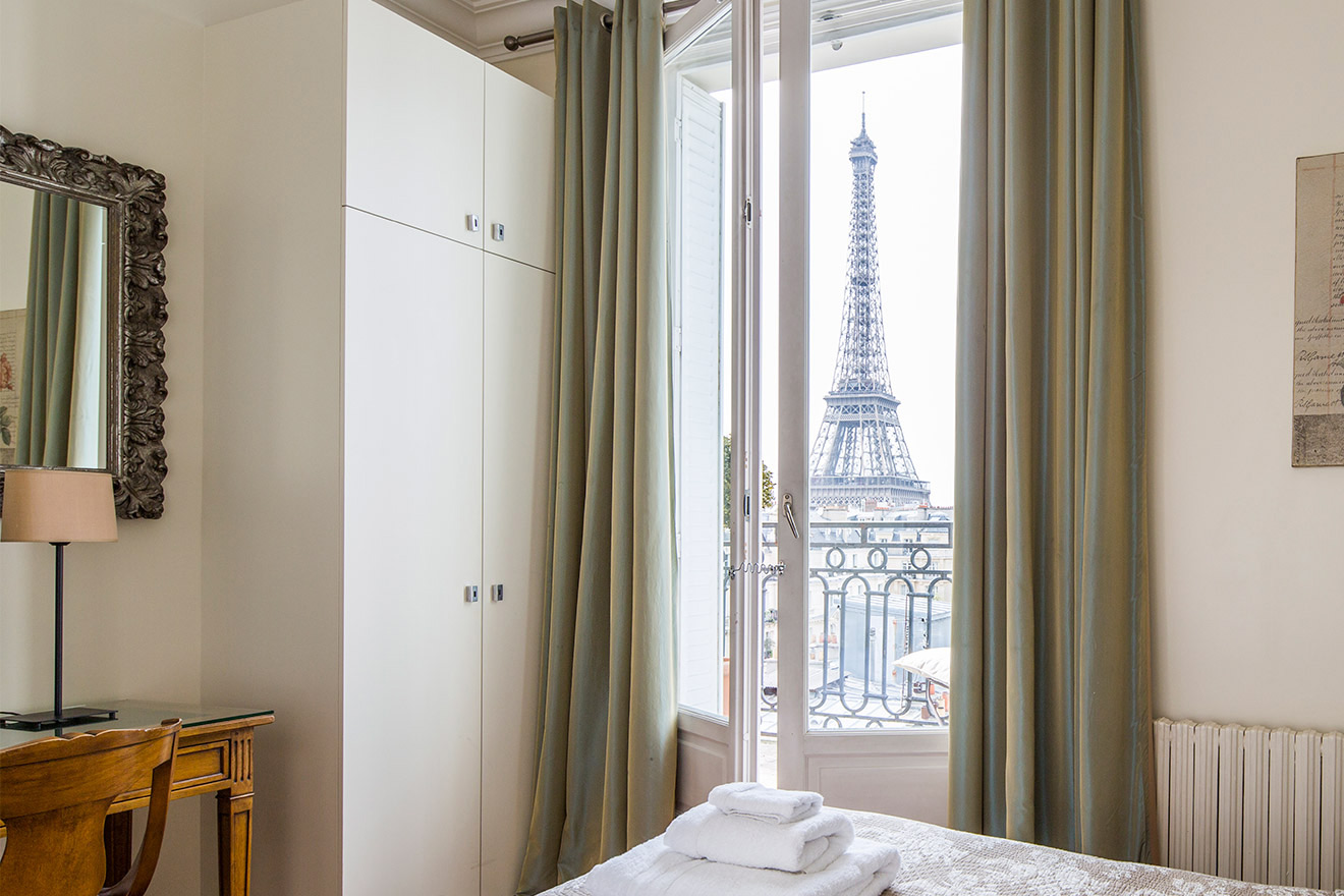 View of the Eiffel Tower from the master bedroom of the Chateau Latour vacation rental offered by Paris Perfect