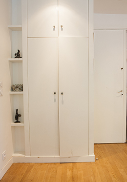 Entrance to fully remodeled bathroom with closet on right