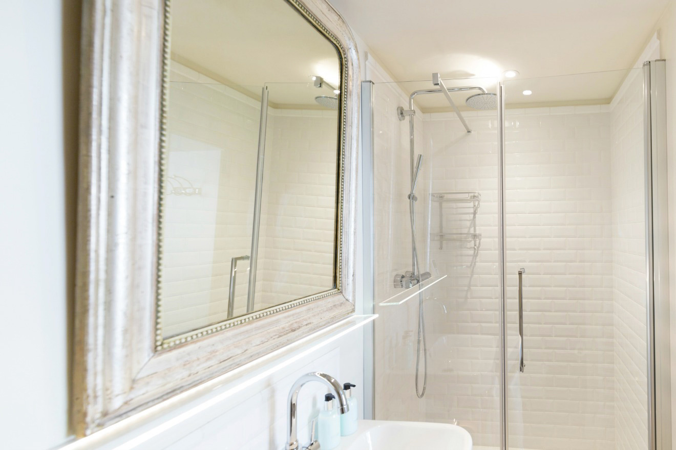 En suite bathroom with shower, sink and toilet in the Castillon vacation rental offered by Paris Perfect