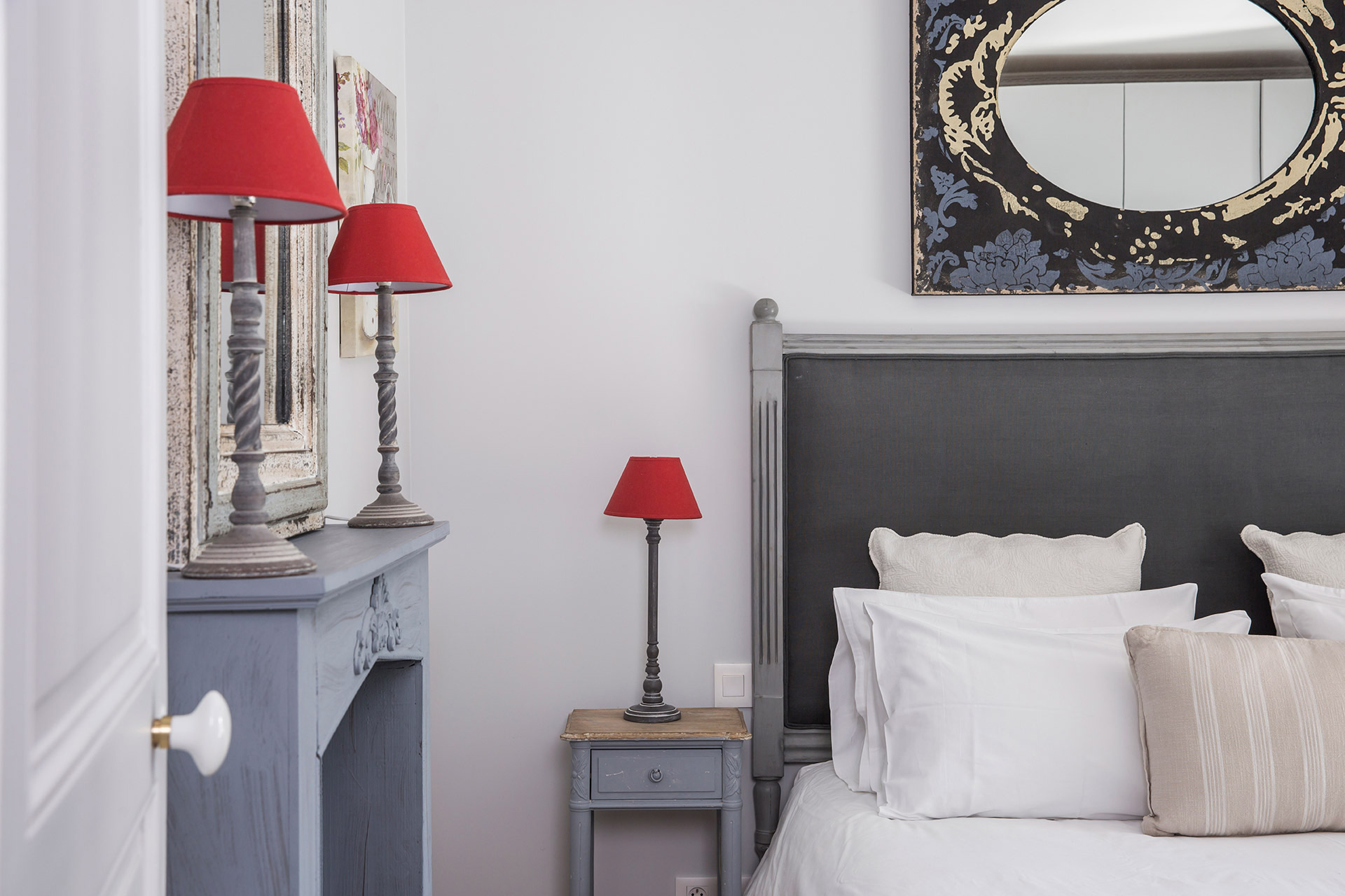 Chic grey tones with red accents in the Chambertin vacation rental offered by Paris Perfect