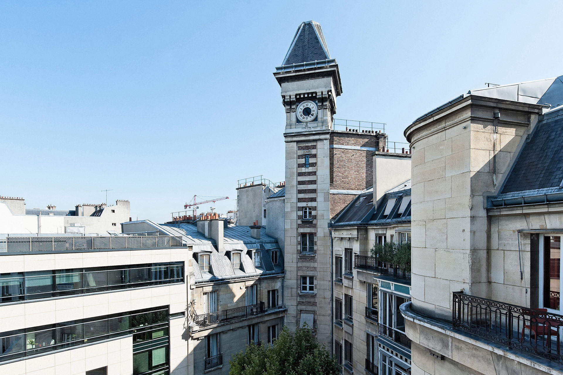 View from kitchen to ancient clock tower in Paris