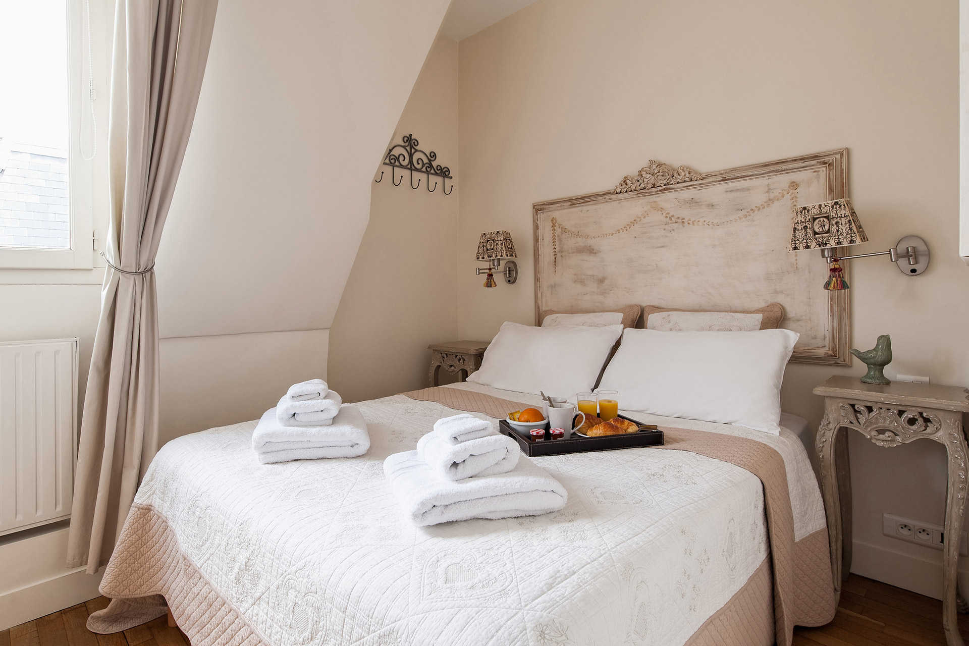 Master bedroom with dual king bed in the Romanée vacation rental offered by Paris Perfect