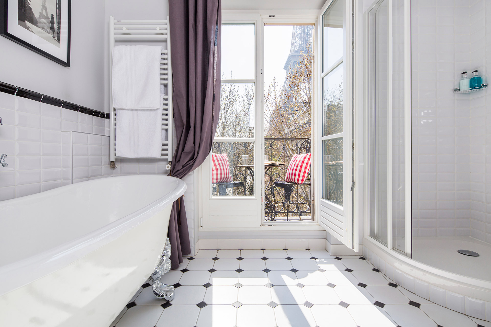 Amazing bathroom with claw foot tub and Eiffel Tower views