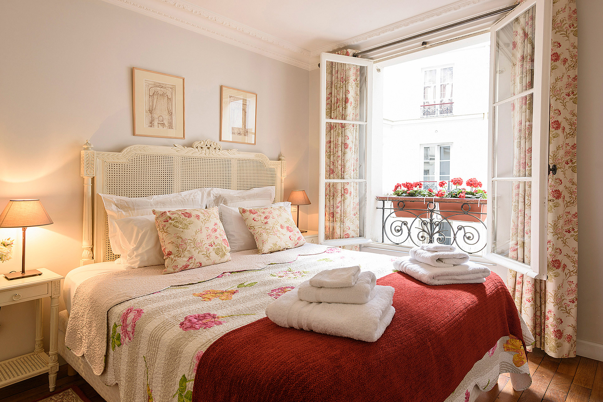 Provencal style bedroom with comfortable extra wide queen bed in the Clairette vacation rental offered by Paris Perfect
