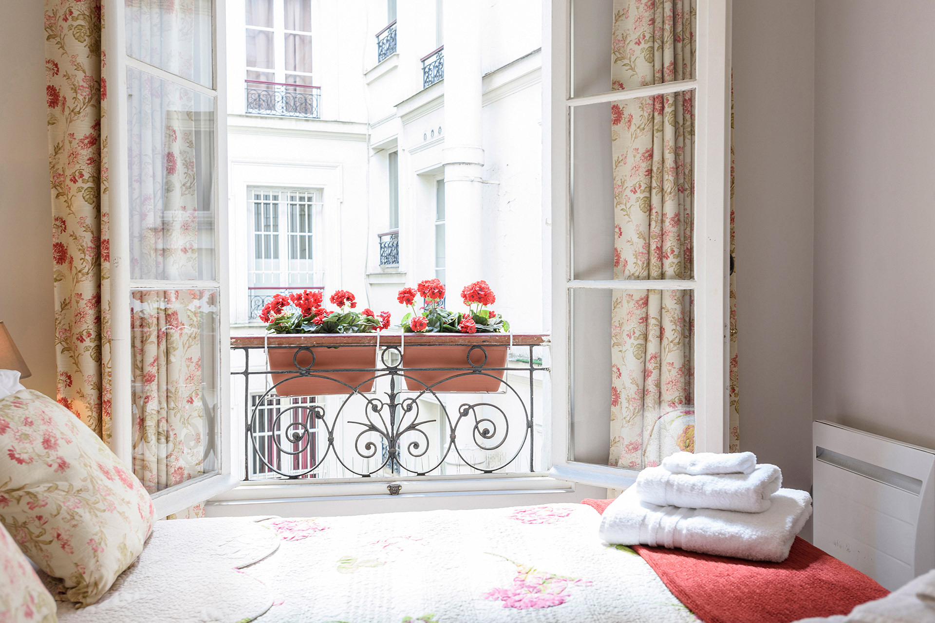 This quiet bedroom overlooks a courtyard in the Clairette vacation rental offered by Paris Perfect