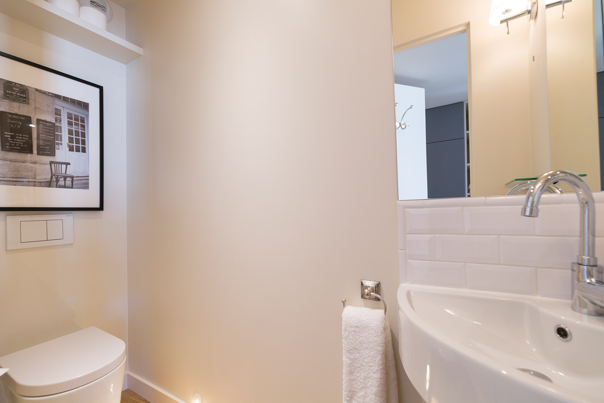 Separate half bath next to the kitchen in the Loupiac vacation rental offered by Paris Perfect