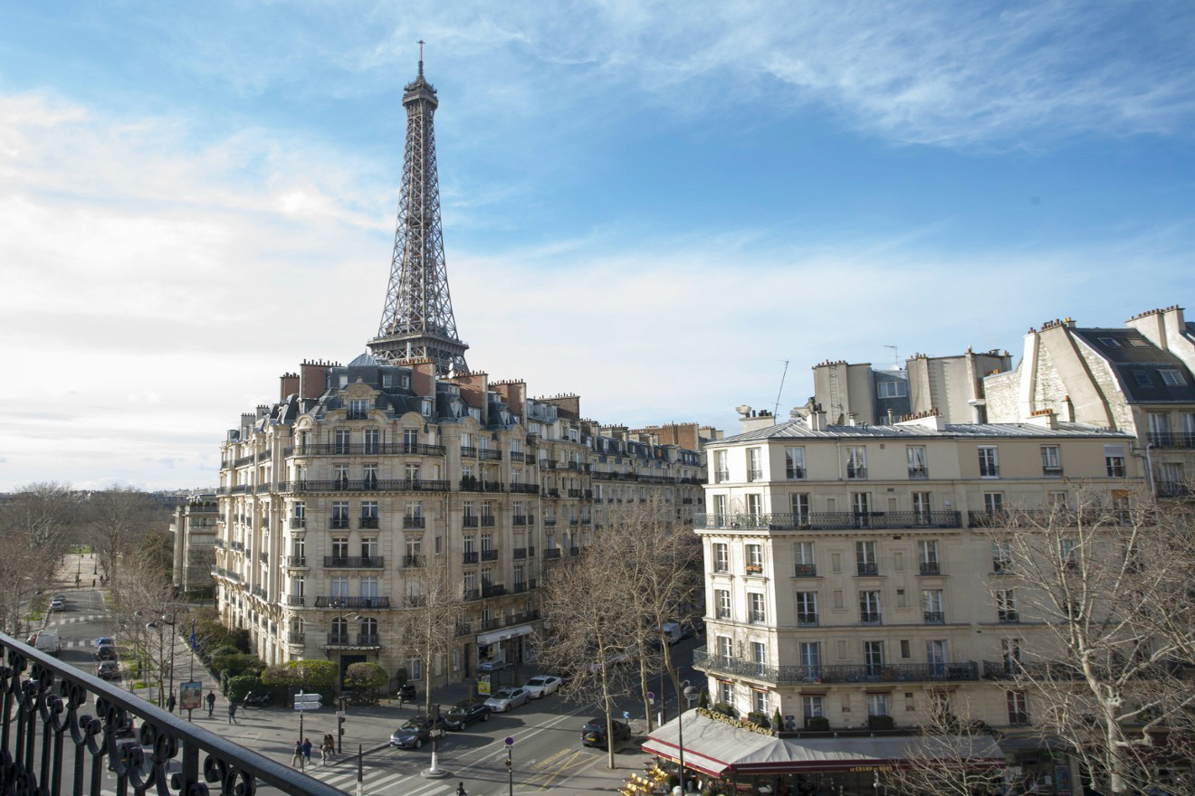 View of the Eiffel Tower from the master bedroom of the Bordeaux vacation rental offered by Paris Perfect
