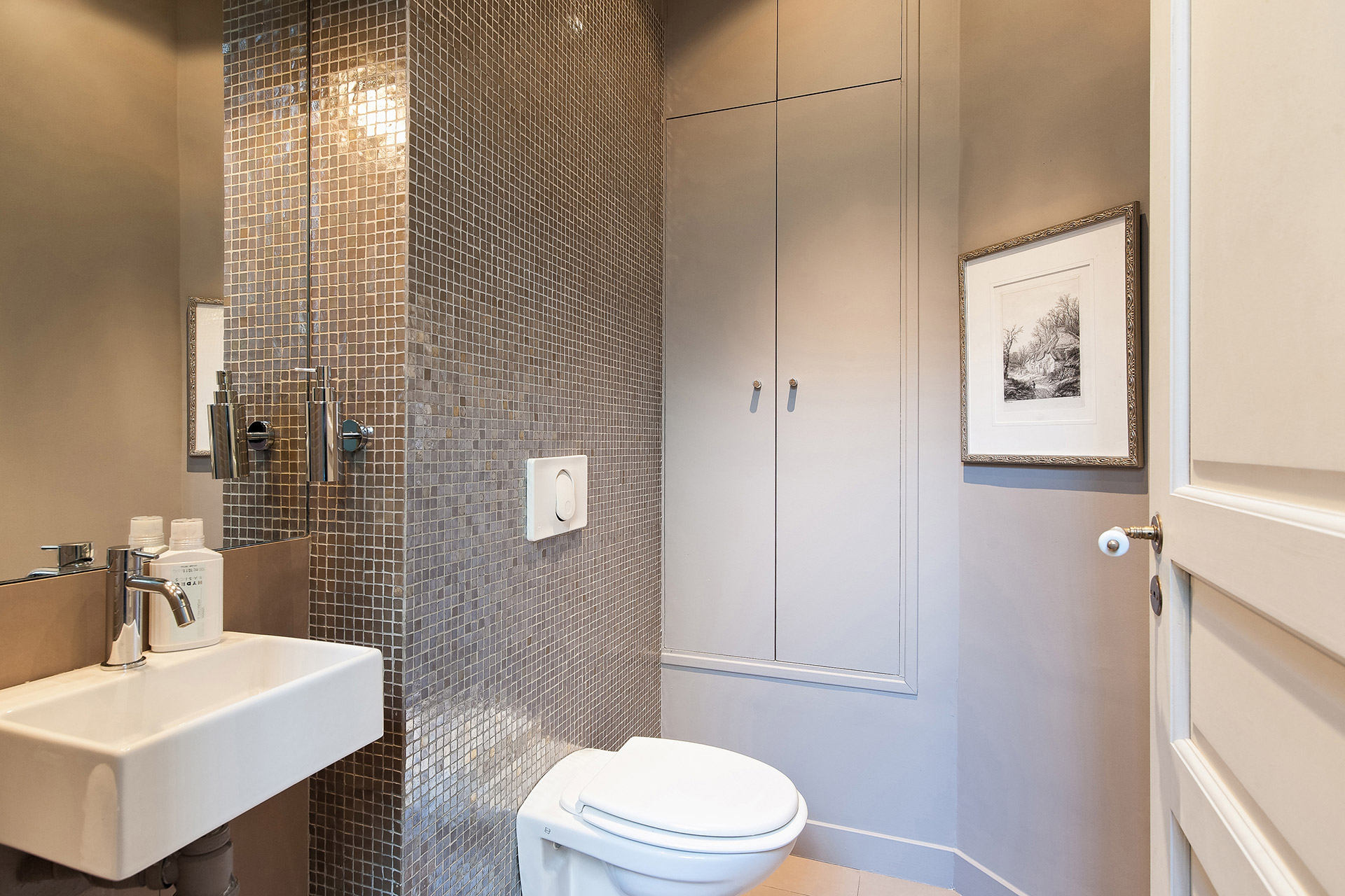 Separate half bath with toilet and sink in the Mâcon vacation rental offered by Paris Perfect