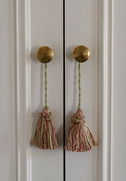 Tassels on the wardrobe doors in the Clairette vacation rental offered by Paris Perfect