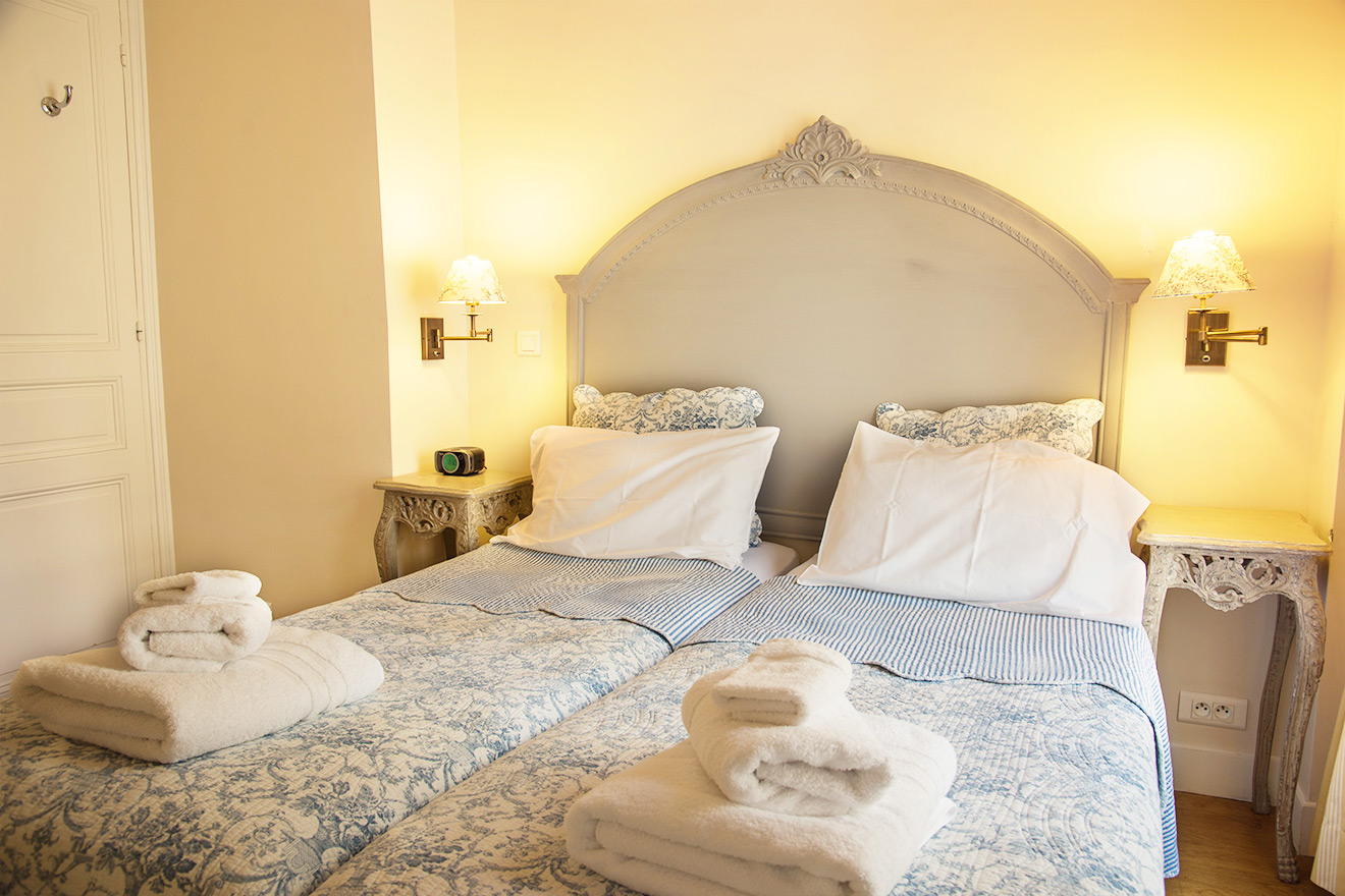 Pretty, pastel blue bedspreads in the second bedroom of the Rully vacation rental offered by Paris Perfect