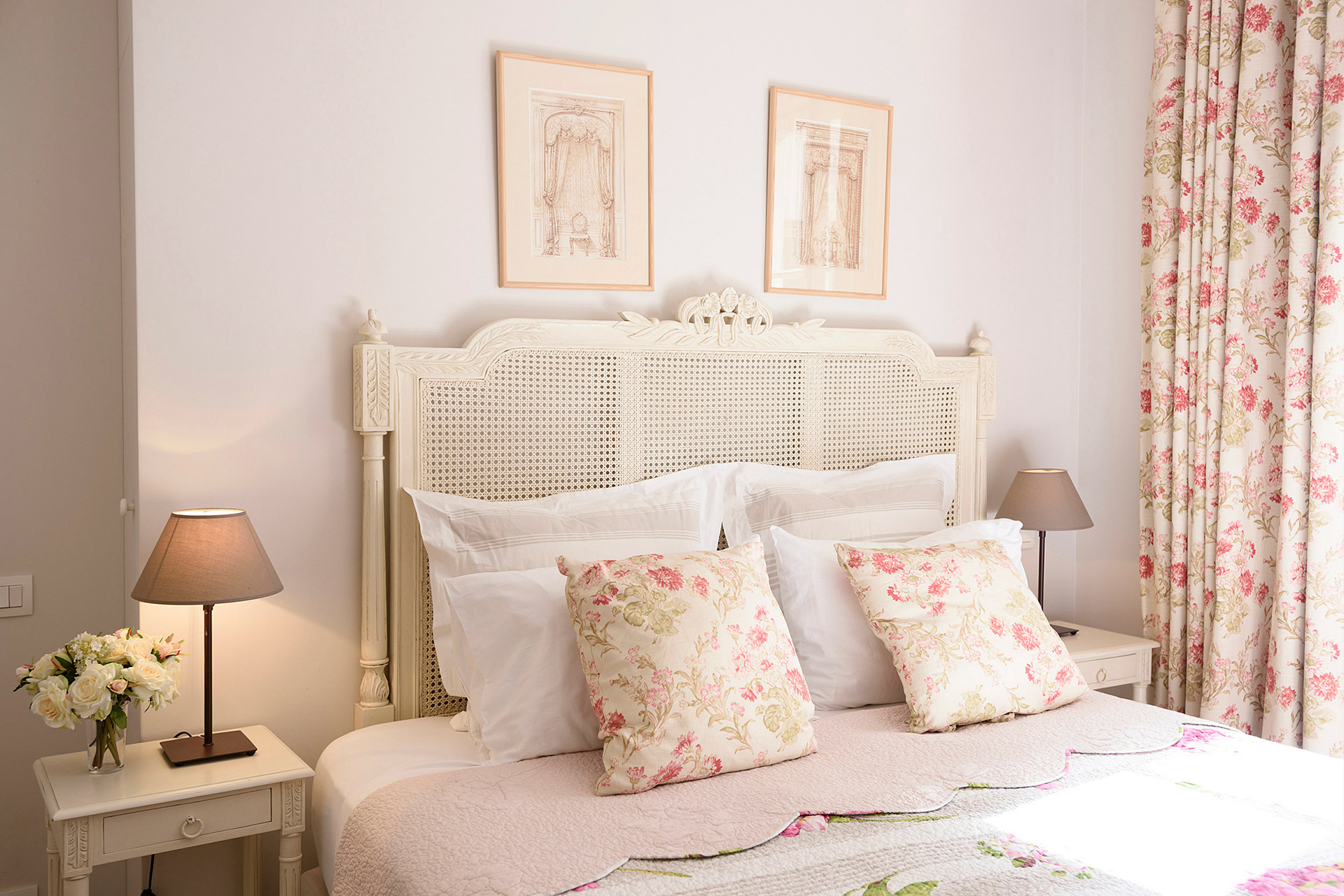 Delicate pink touches in the bedroom of the Clairette vacation rental offered by Paris Perfect