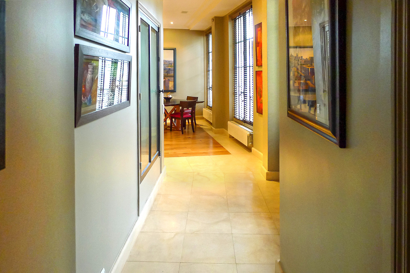 Hallway leading toward the dining room and kitchen