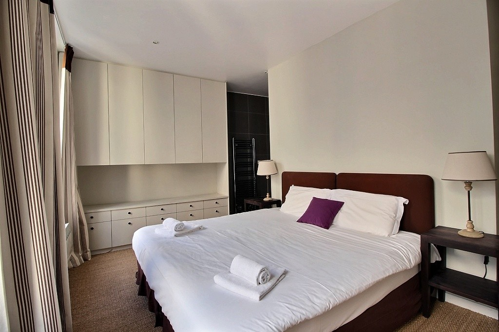 Spacious lower level bedroom with en suite bathroom