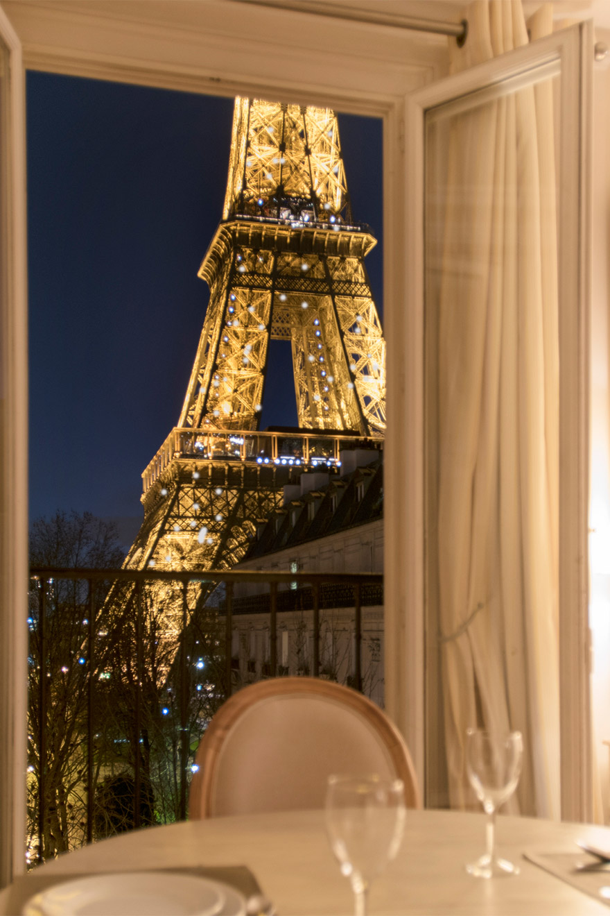 Incredible view of the Eiffel Tower from the living room of the Saint Emilion vacation rental offered by Paris Perfect