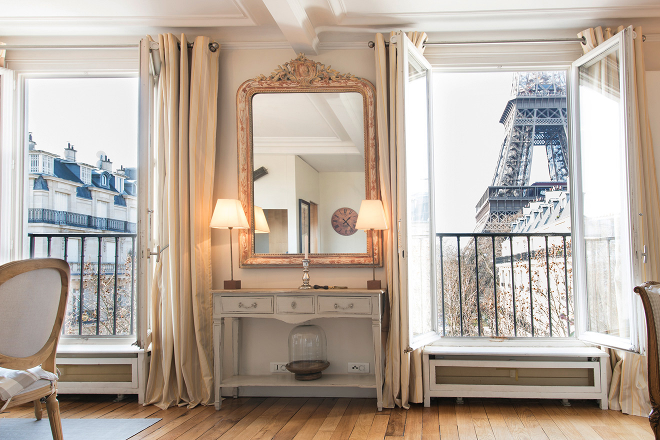 Magnificent living and dining area views of the Eiffel Tower