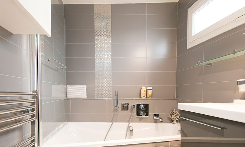 En suite bathroom features heated towel rails in the Carménère vacation rental offered by Paris Perfect