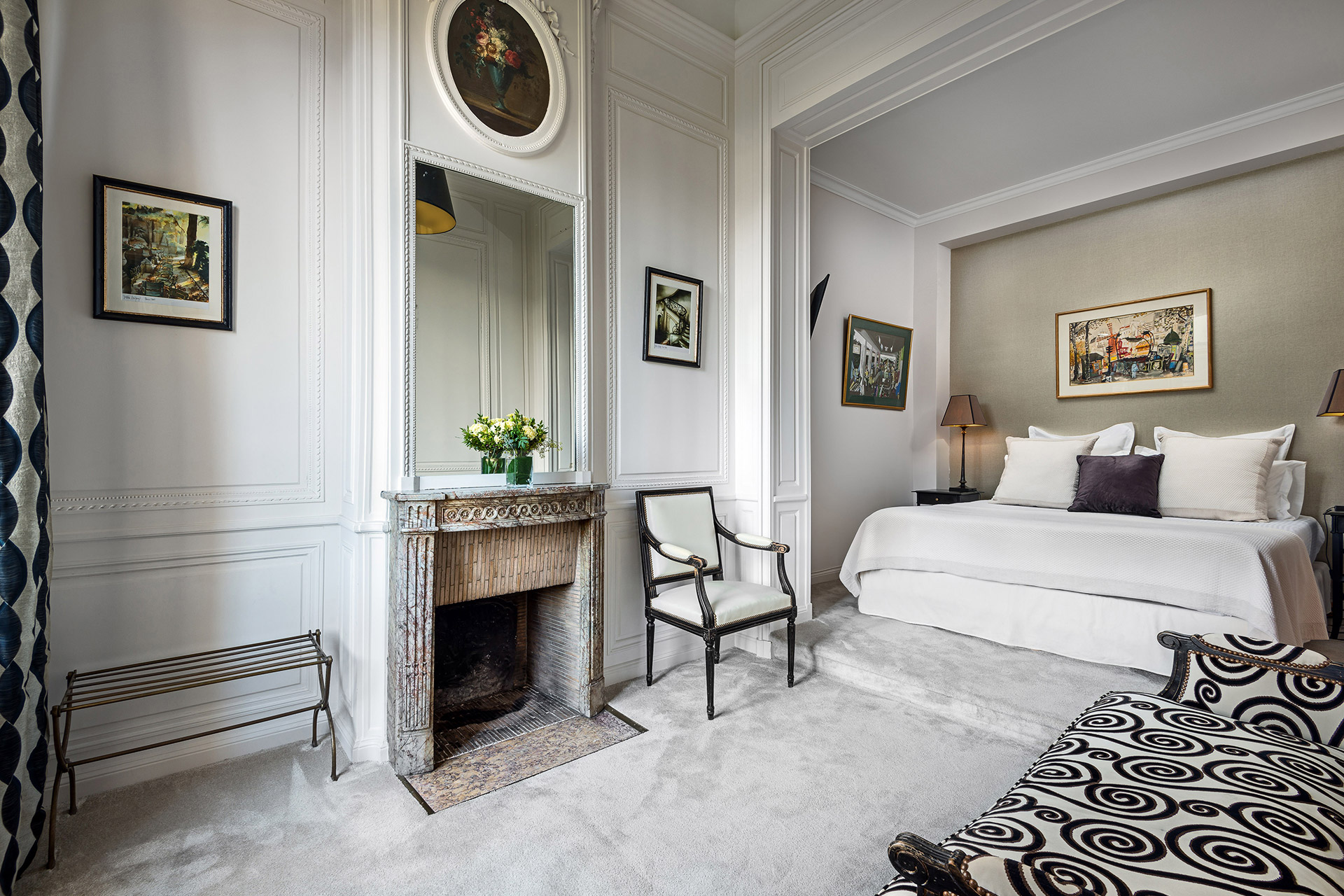 Refined artistic choices in the bedroom of the Chopine vacation rental offered by Paris Perfect