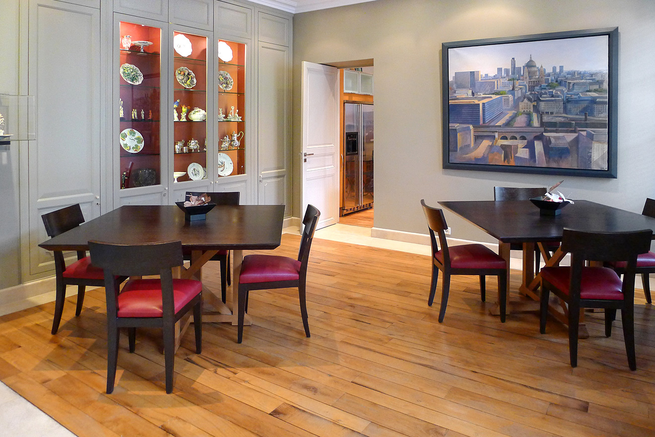 Large dining room with two tables and comfortable chairs